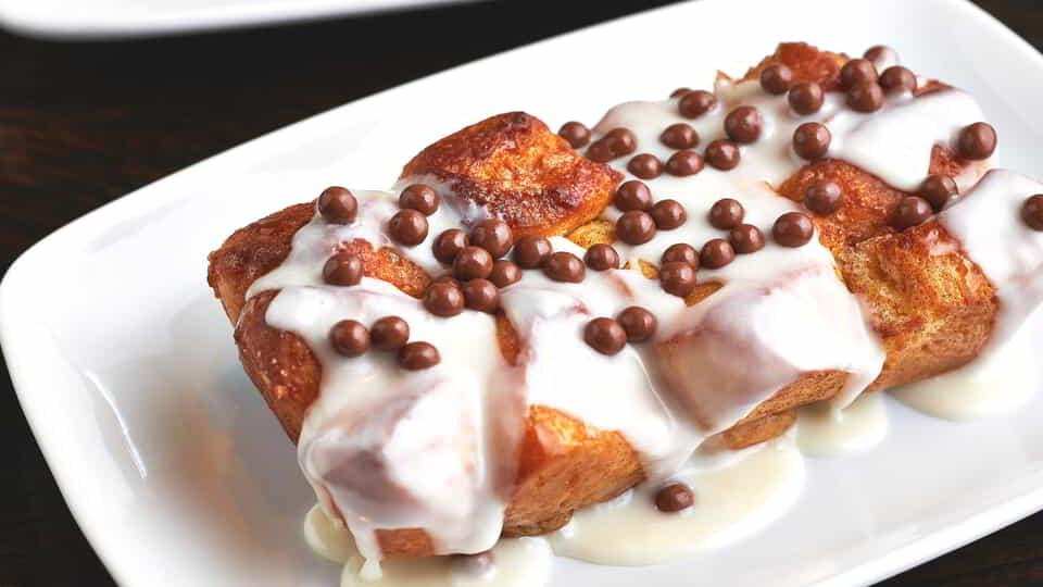 Enjoy warm cinnamon buns at ARIA Cafe