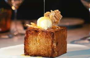 BARDOT's delicious sweet and savory brunch dishes include the iconic three inch tall Brioche French Toast.