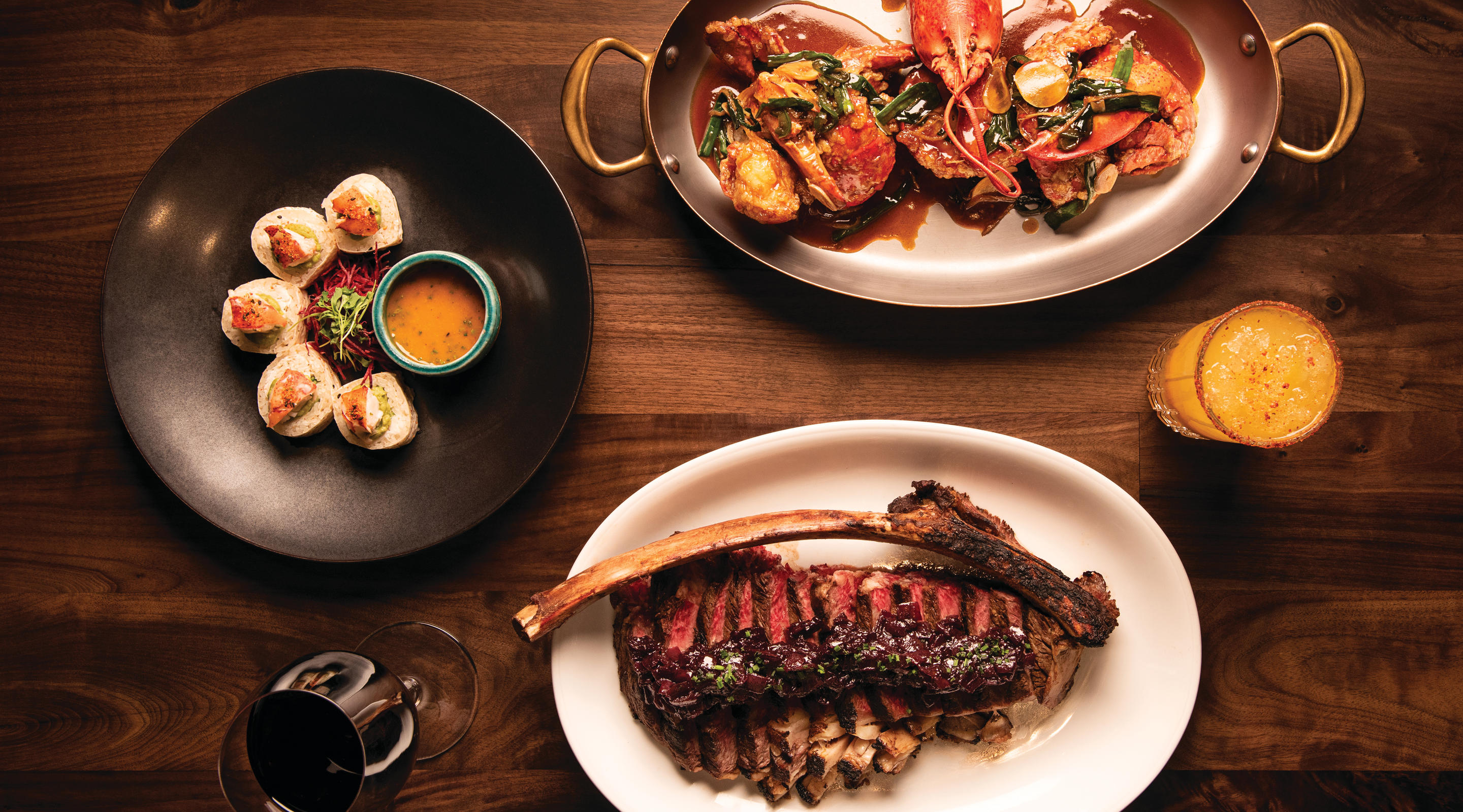Surf and turf with a Tomahawk steak and a lobster tail.