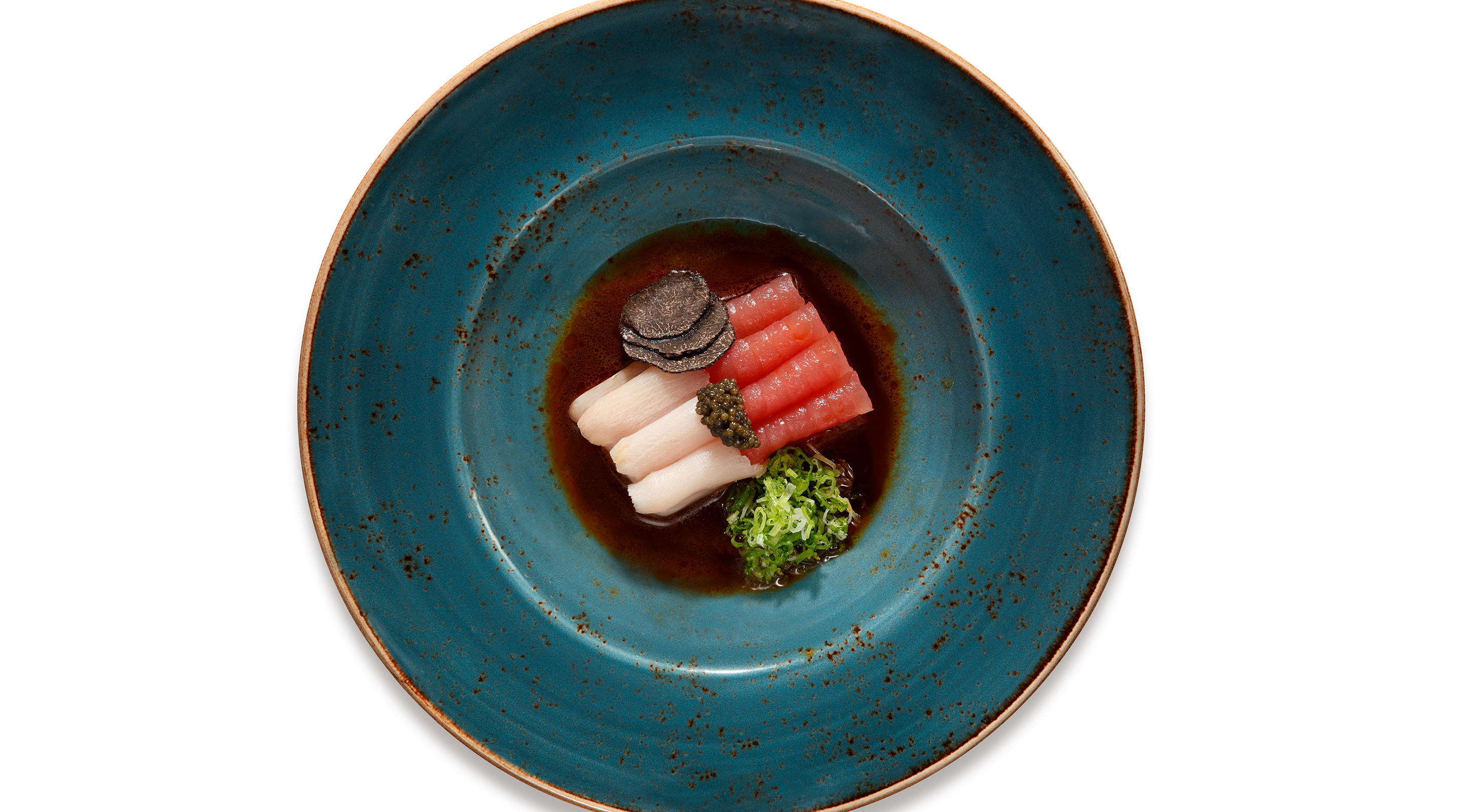 Enjoy signature dishes such as the Truffle Sashimi at CATCH.