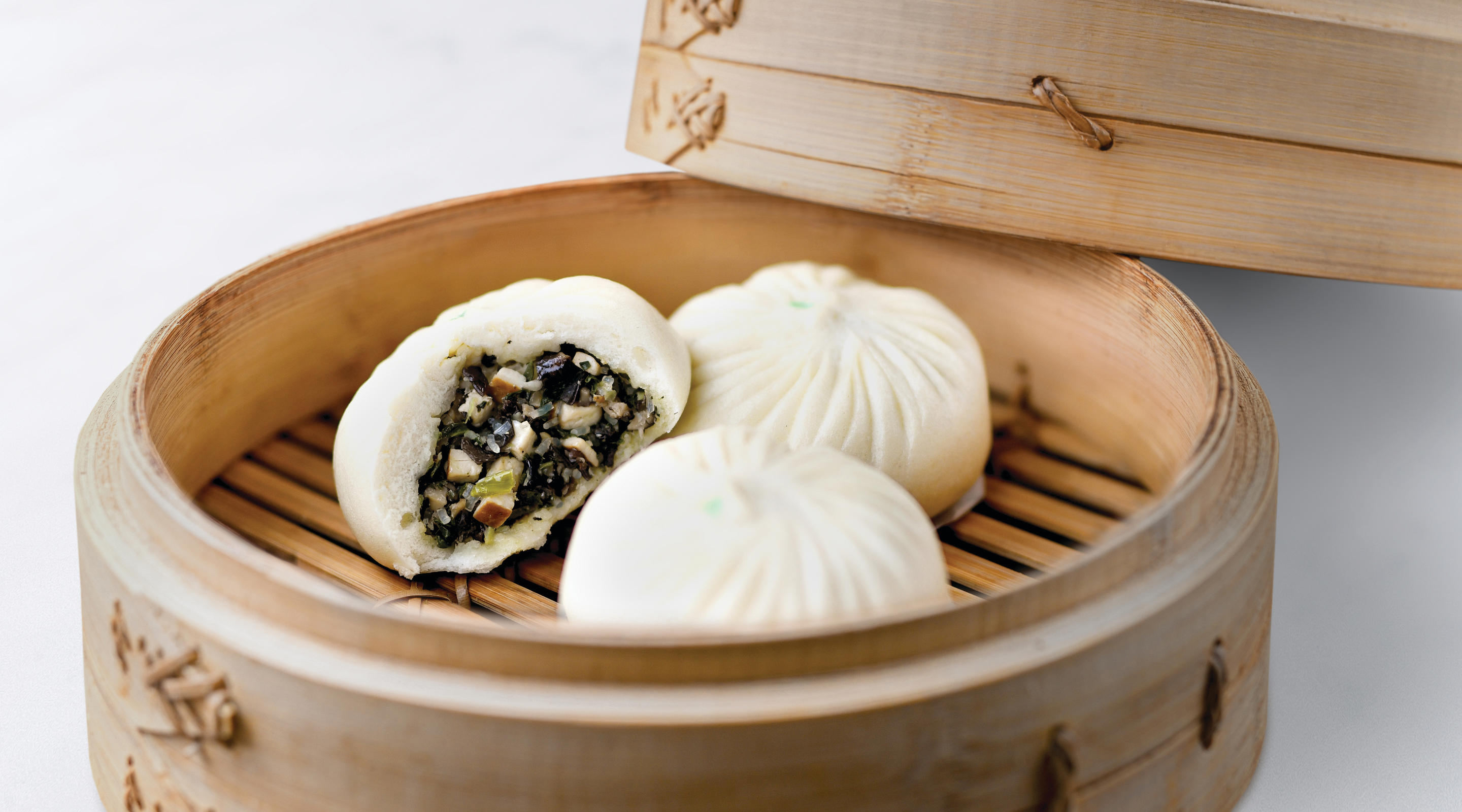 Steamed buns filled with mushroom and vegetables.