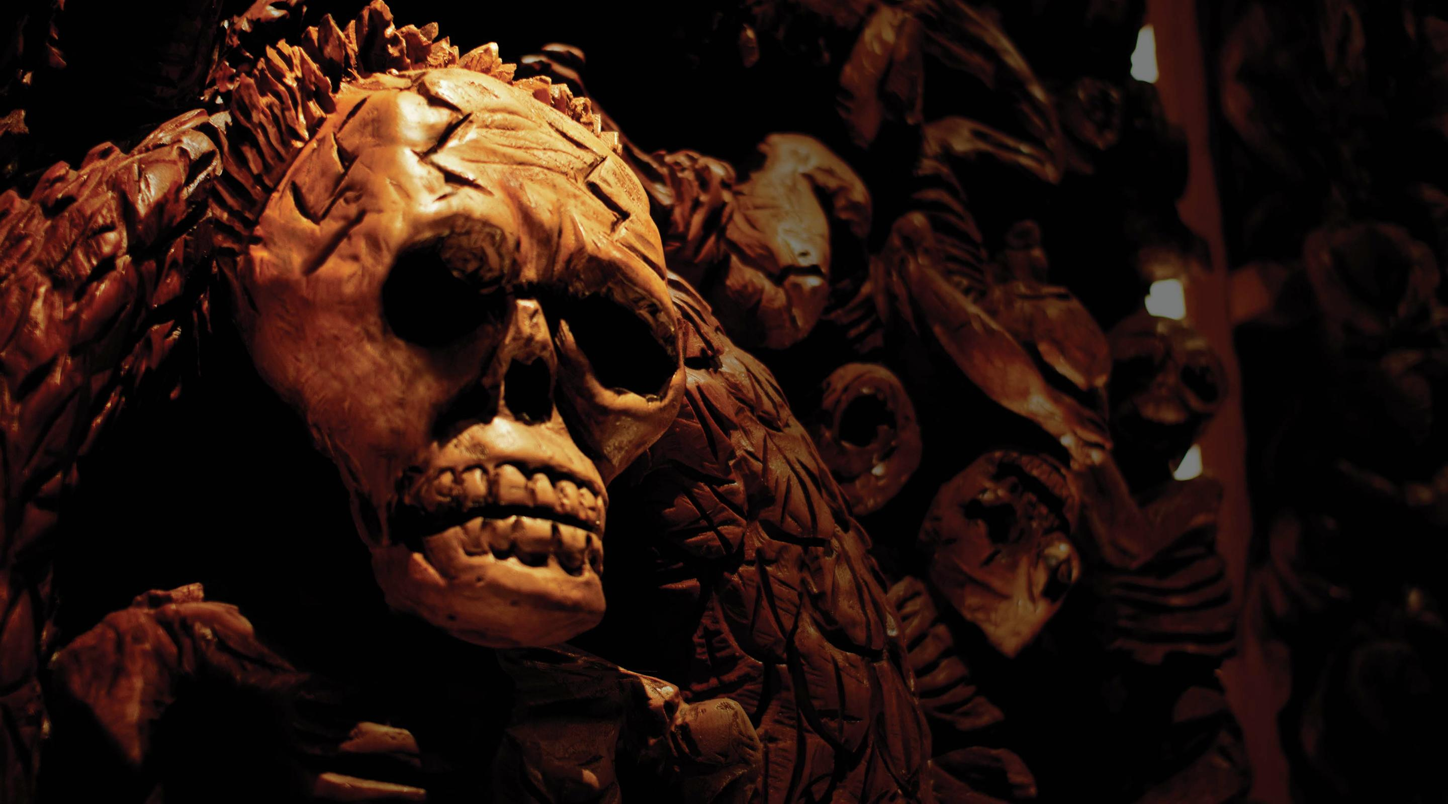 Javier's main dining room features a chainsaw wood carving highlighting the Aztec civilization.