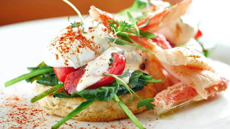 Nosh on Lobster Eggs Benedict from Julian Serrano.
