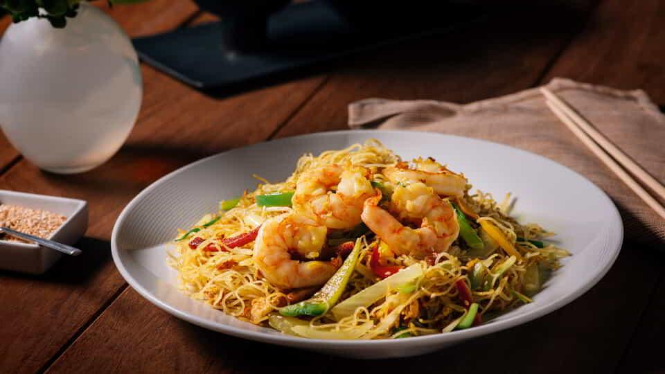 The Singapore Noodles at Lemongrass is the perfect dish to complement your meal.