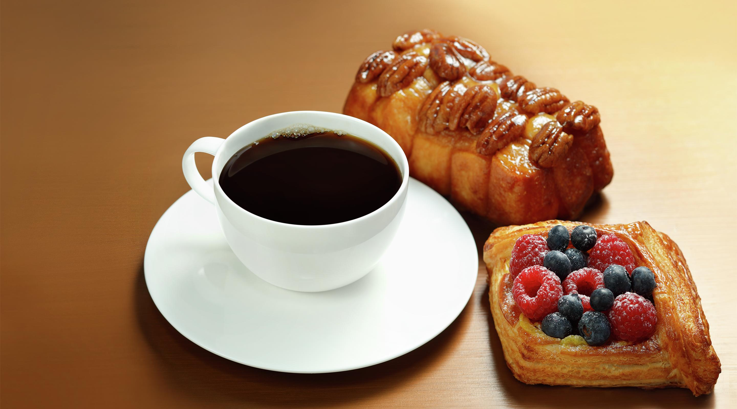 Classic breakfast items include coffee and fresh pastries.