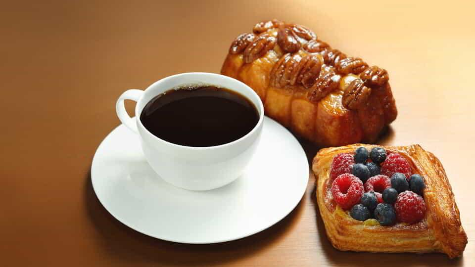 Classic breakfast items from ARIA Patisserie include coffee and fresh pastries.
