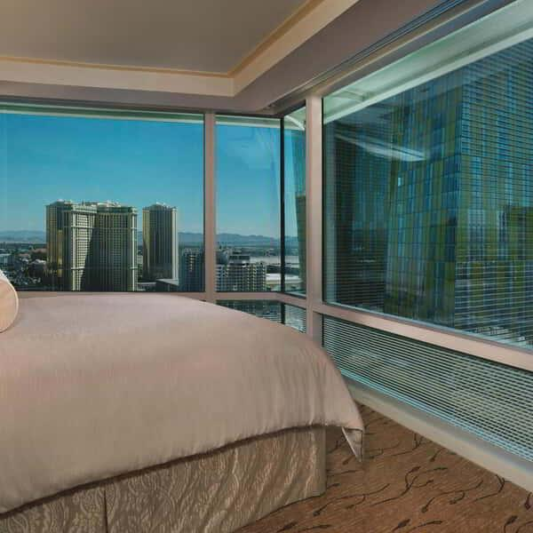 aria-hotel-corner-suite-bedroom-city-view