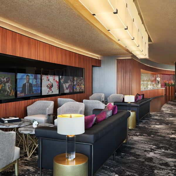 Enjoy the naturally lit atmosphere and comfortable furnishing in ARIA's Resort Club Lounge.