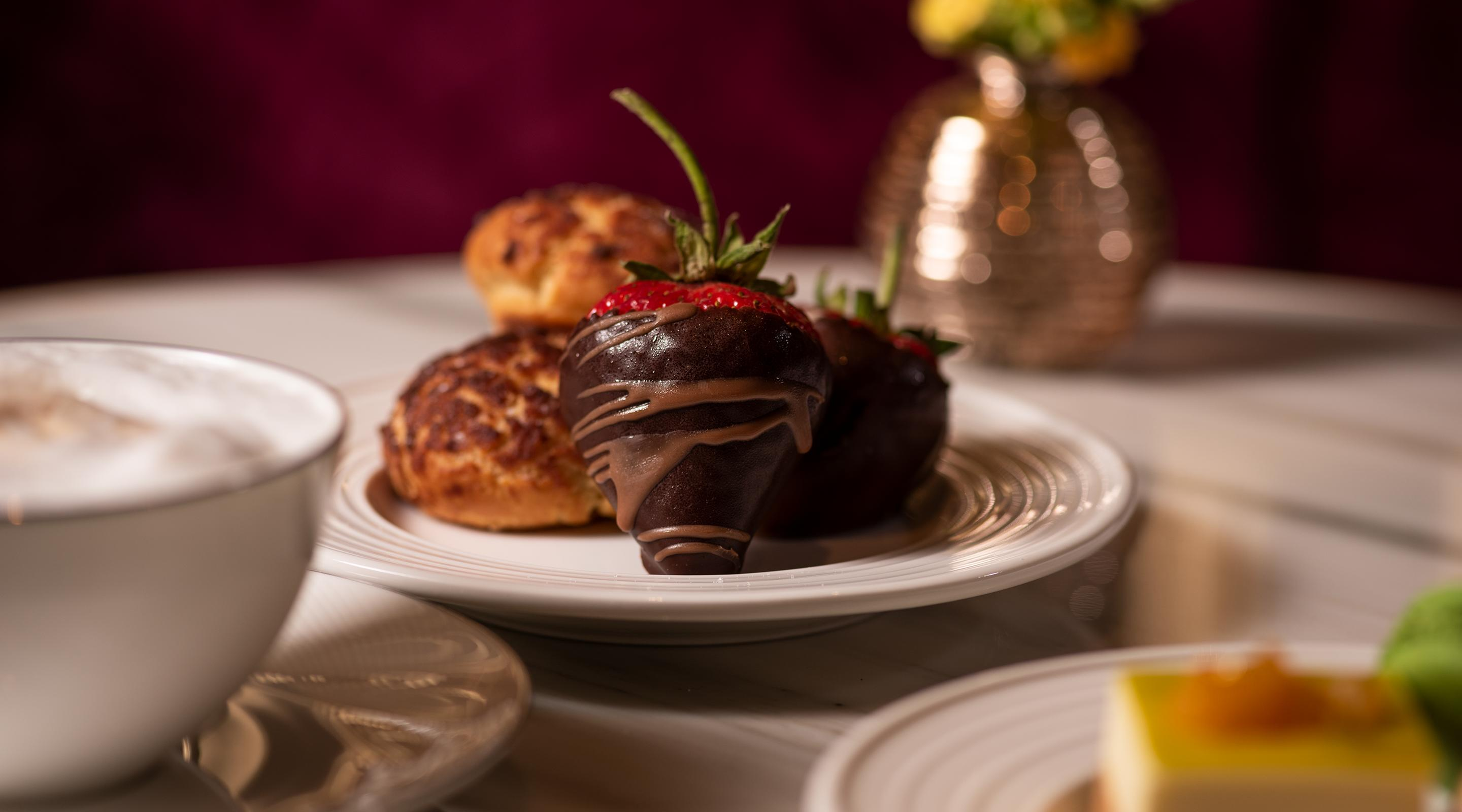 Chocolate-dipped strawberries, French macarons, and caramel chouquette headline the desserts available on a nightly basis.