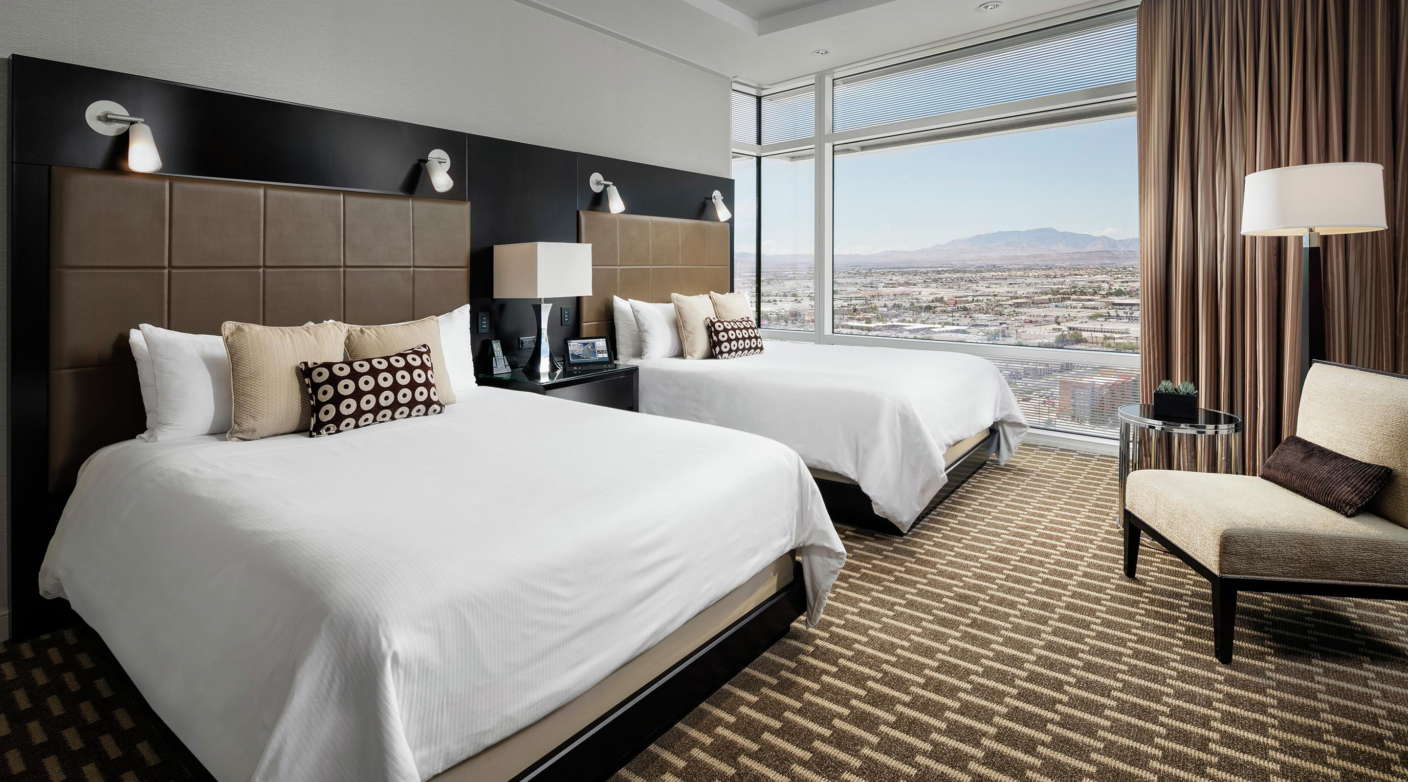 Approximately 1,050 square feet of sheer opulence. Our one-touch, in-room technology. And, of course, stunning views through the floor-to-ceiling windows.