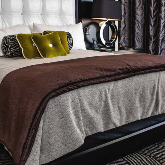 Inhale the soothing aroma of vanilla blended with Eastern-inspired wood grains. Wrap yourself in your 100% Egyptian cotton sheets, and sink into all twelve layers of your bed's custom-designed comfort system.  The Las Vegas Strip may be hundred of miles away, but you get to relive ARIA every night.