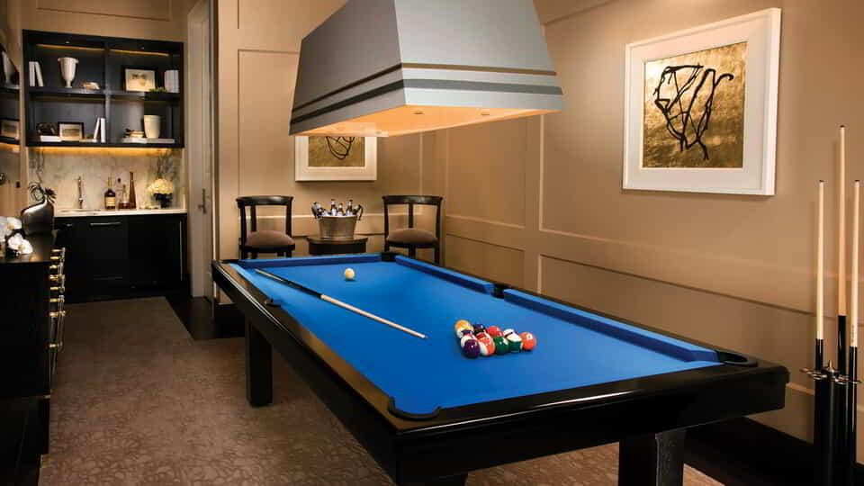 Pool table inside the room.