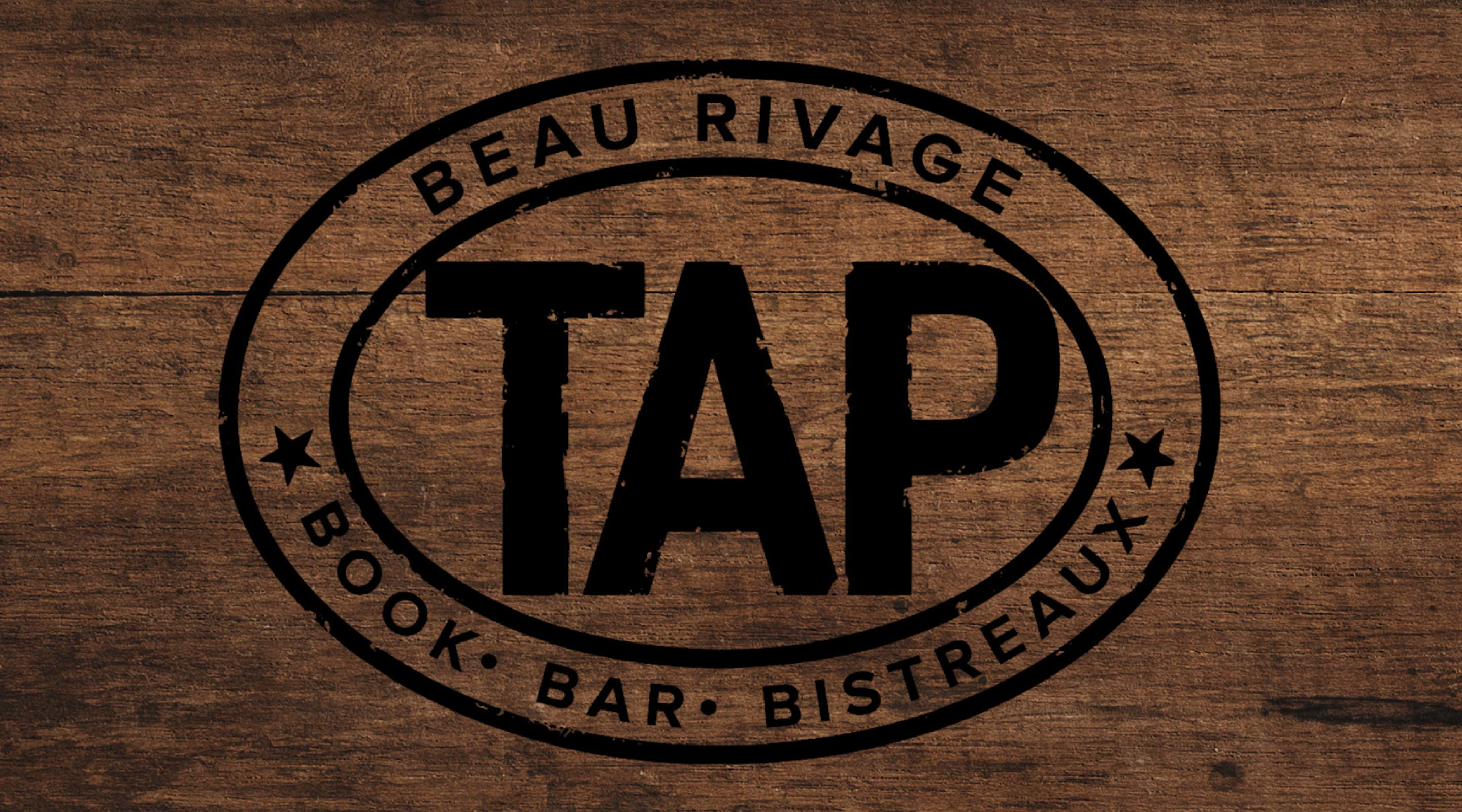 TAP logo on the wood background