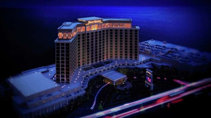 Tilt shift image of Beau Rivage at night.