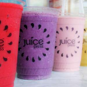 Juice Press smoothies in lined up cups.