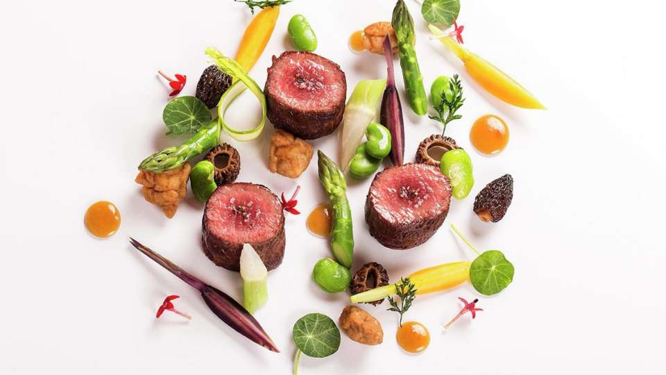 Lamb and vegetables are served at Le Cirque.
