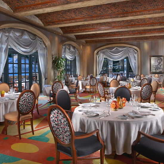 The Picasso restaurant interior dining area with windows.