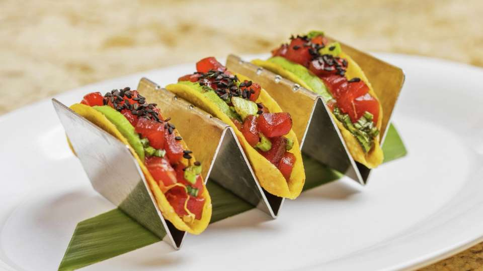 Enjoy a light and refreshing meal with our Ahi Poke Tacos.