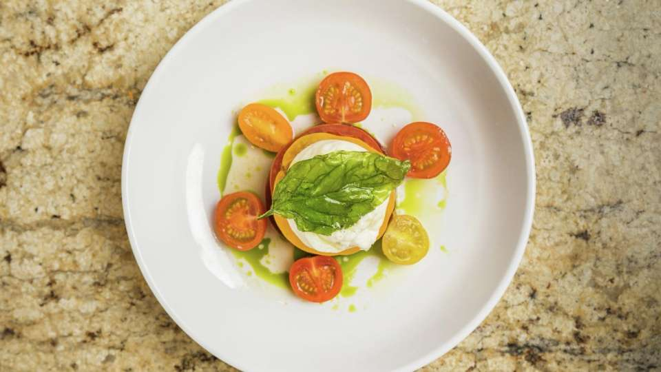 Delicious and light Heirloom Tomato Burrata at the Pool Cafe.