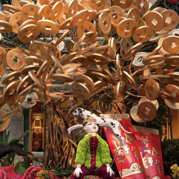 Chinese New Year 2018 features the coin tree with dogs.