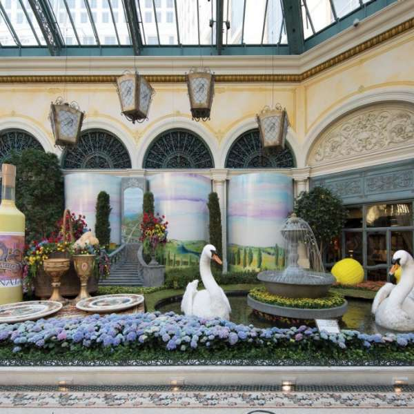 A wine bottle and two swans in the Conservatory at Bellagio.