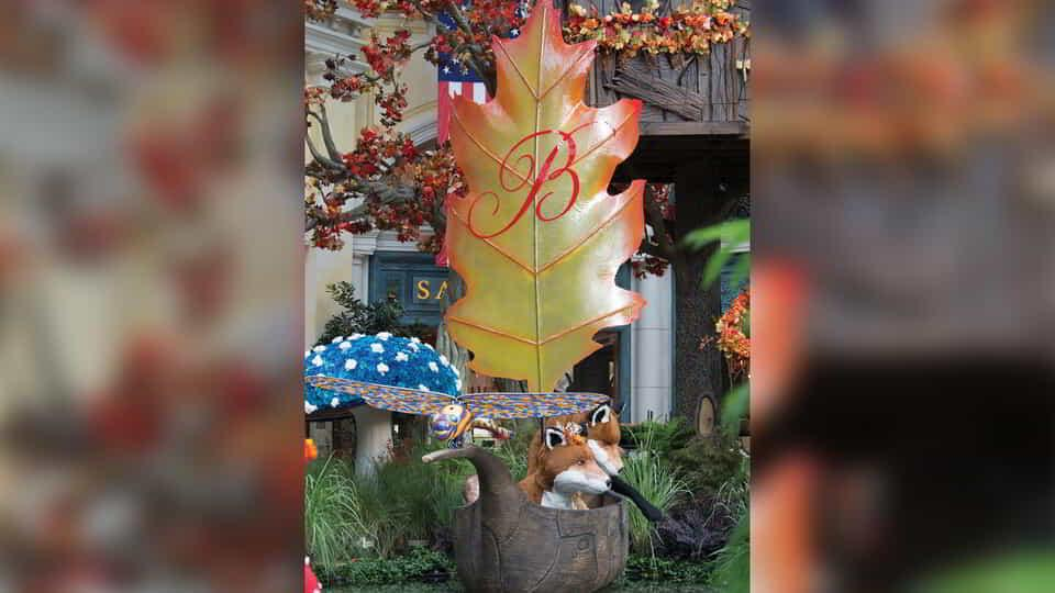 The Bellagio Conservatory display with large autumn leaf and two foxes.