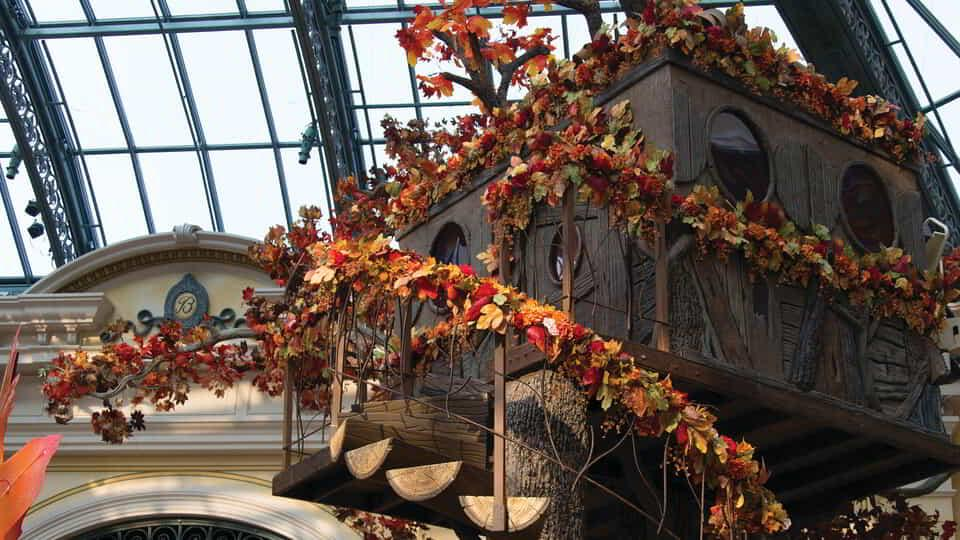 The tree house installation surrounded by foliage at the Bellagio Conservatory.