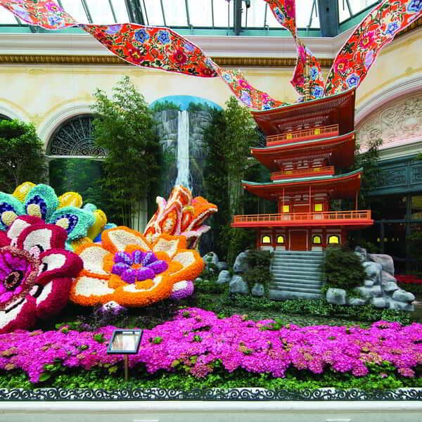 A wide shot of the orange house and flower bed in Bellagio Conservatory.