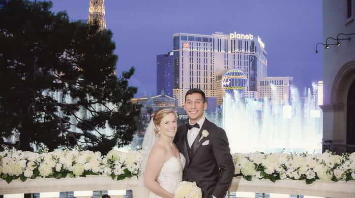 A newly wed couple at the Bellagio Fountain