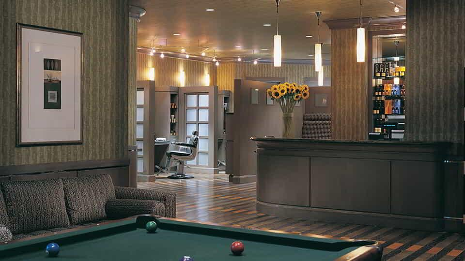 View of billiard table and counter in the barbershop.