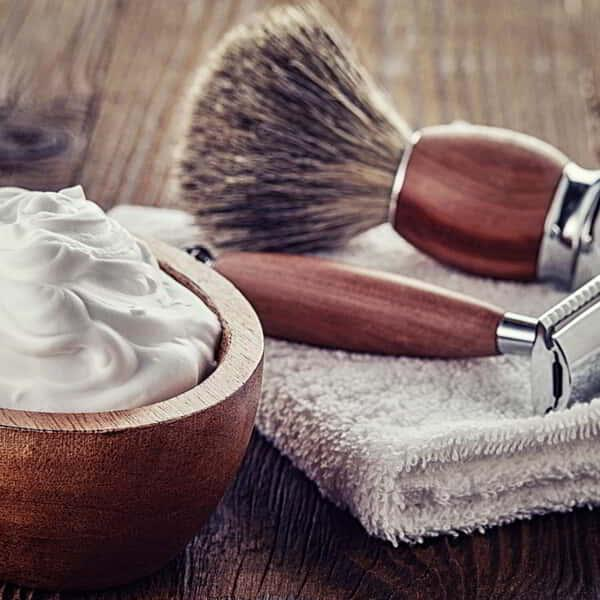 Shaving accessories on wooden background.