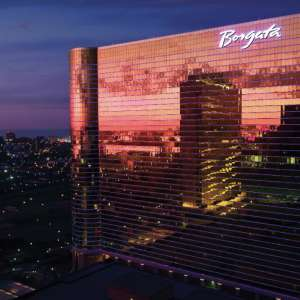 Borgata building in the evening with the Atlantic City skyline.