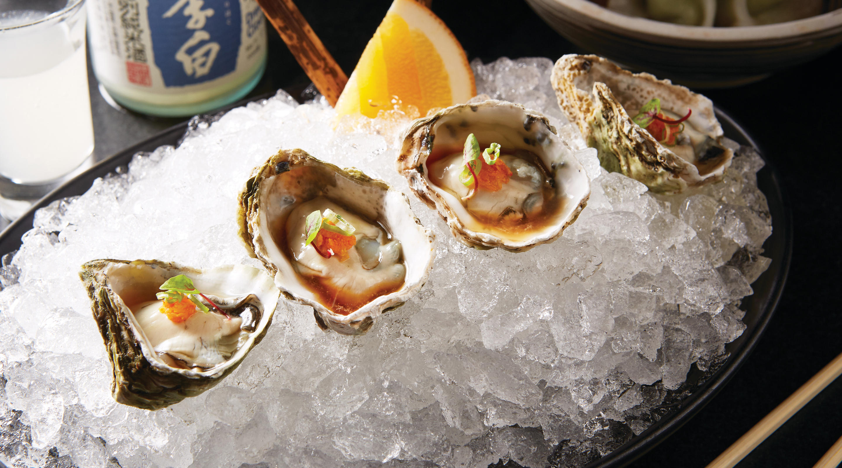 Kusshi Oysters on ice, with lemon kosho, ponzu, and scallion.