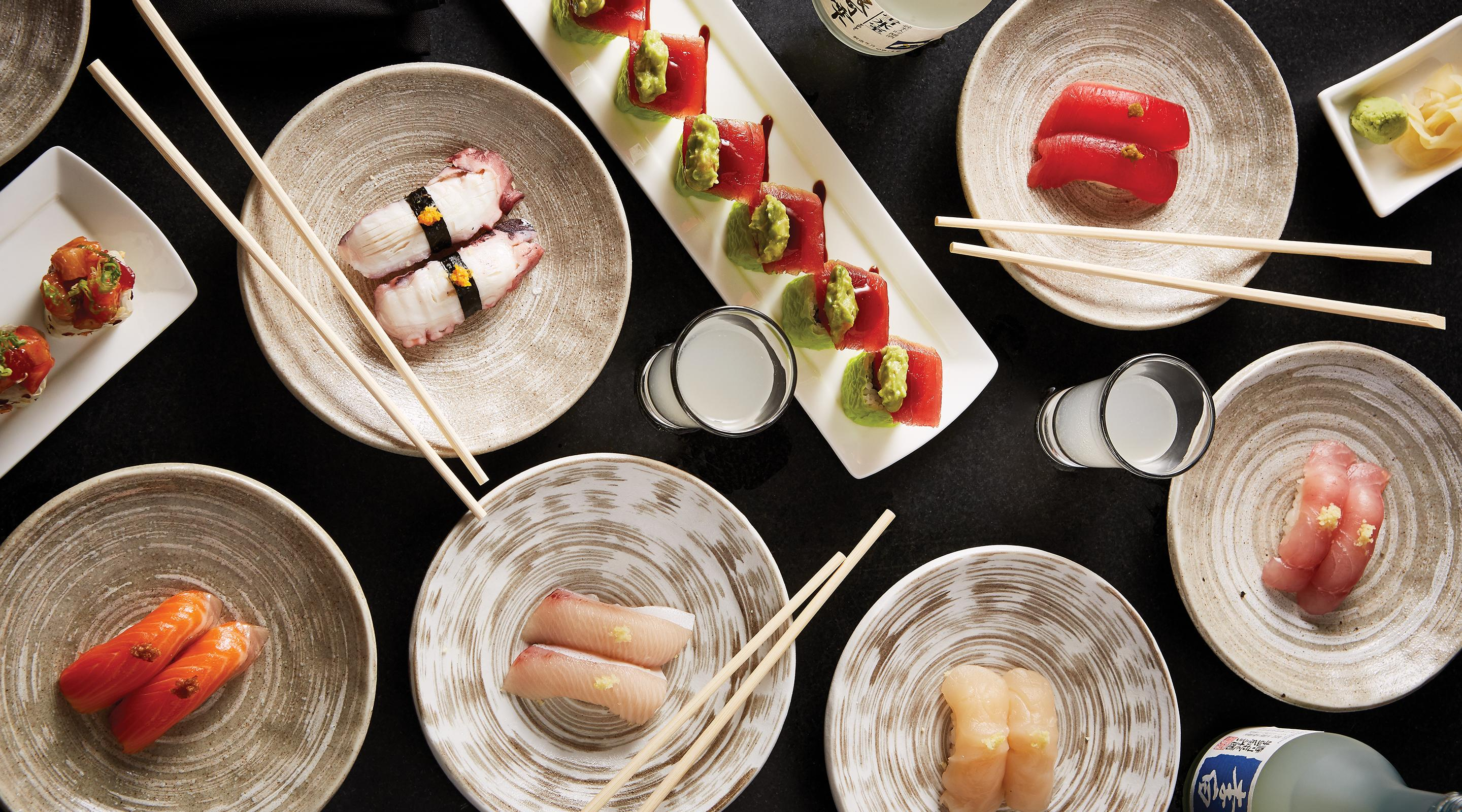 A tablescape of assorted pieces of sashimi and sushi.