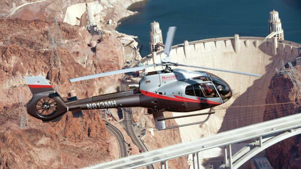 Maverick helicopter flying over Hoover Dam.