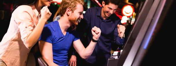 Couple playing at a slot machine