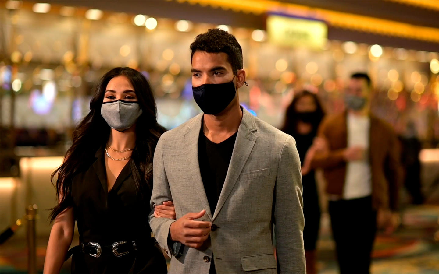 A couple wearing masks