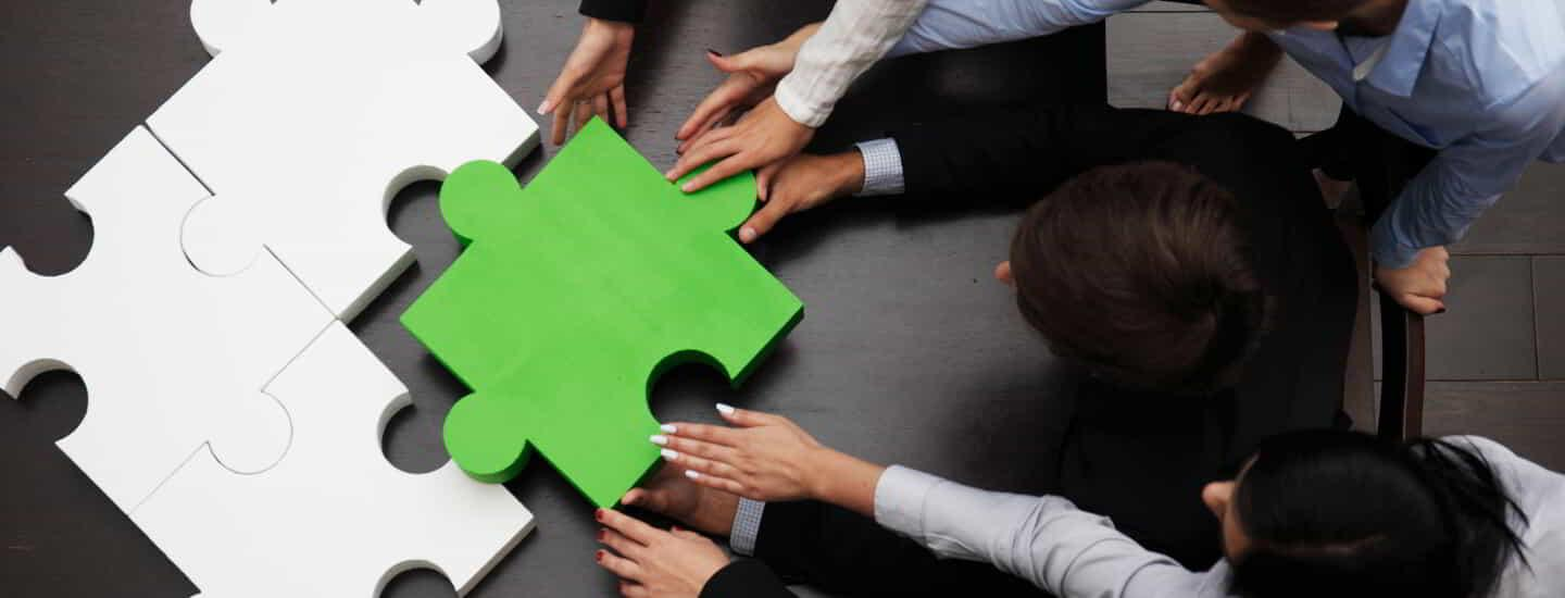 Concept of business team solving puzzle stock image.