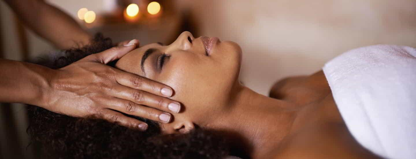 Shot of a beautiful young woman getting a head massage at a spa.