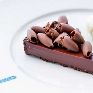 Taste the chocolate tart at Rivea by Chef Alain Ducasse.