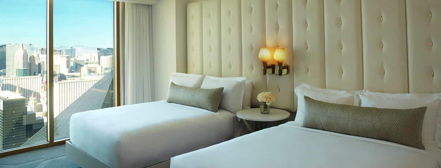 delano-las-vegas-hotel-queen-suite-beds-day-time-curtain-open