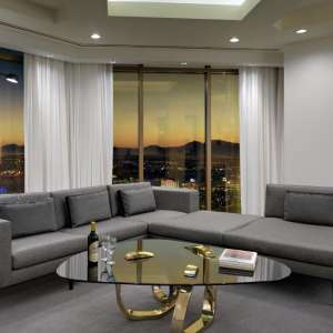 Delano Las Vegas apartment living room features plush lounge seating in deep grey tones.