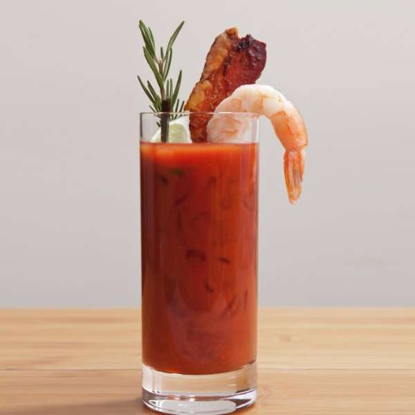 Delicious bloody mary cocktail with bacon and shrimp from our catering cocktail menu.