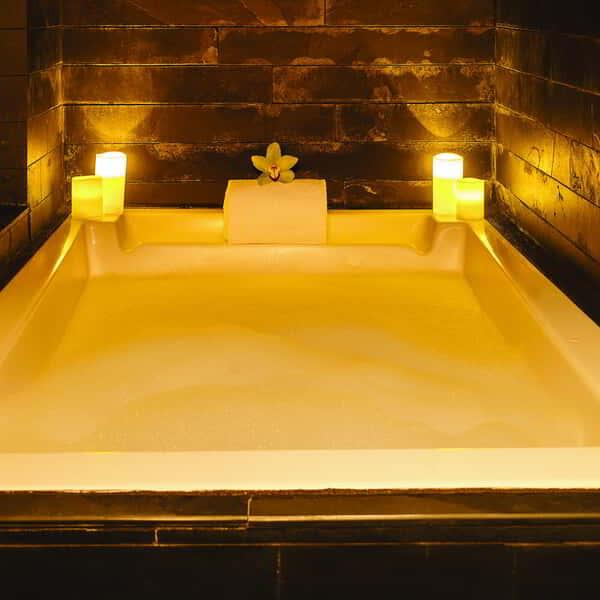 A candlelit bathtub in the BATHHouse Spa and Salon.