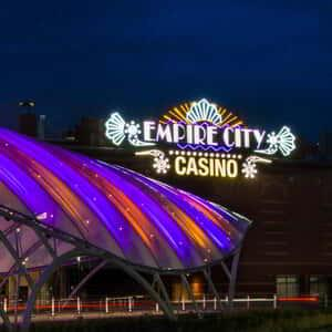 Front view of the Empire City Casino property at night.