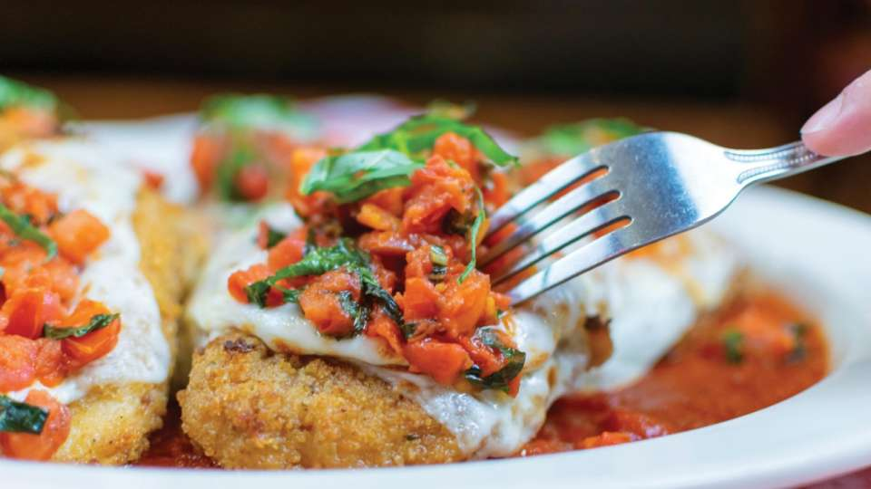 CHICKEN PARMASIANA – Topped with our house-made marinara sauce and mozzarella.