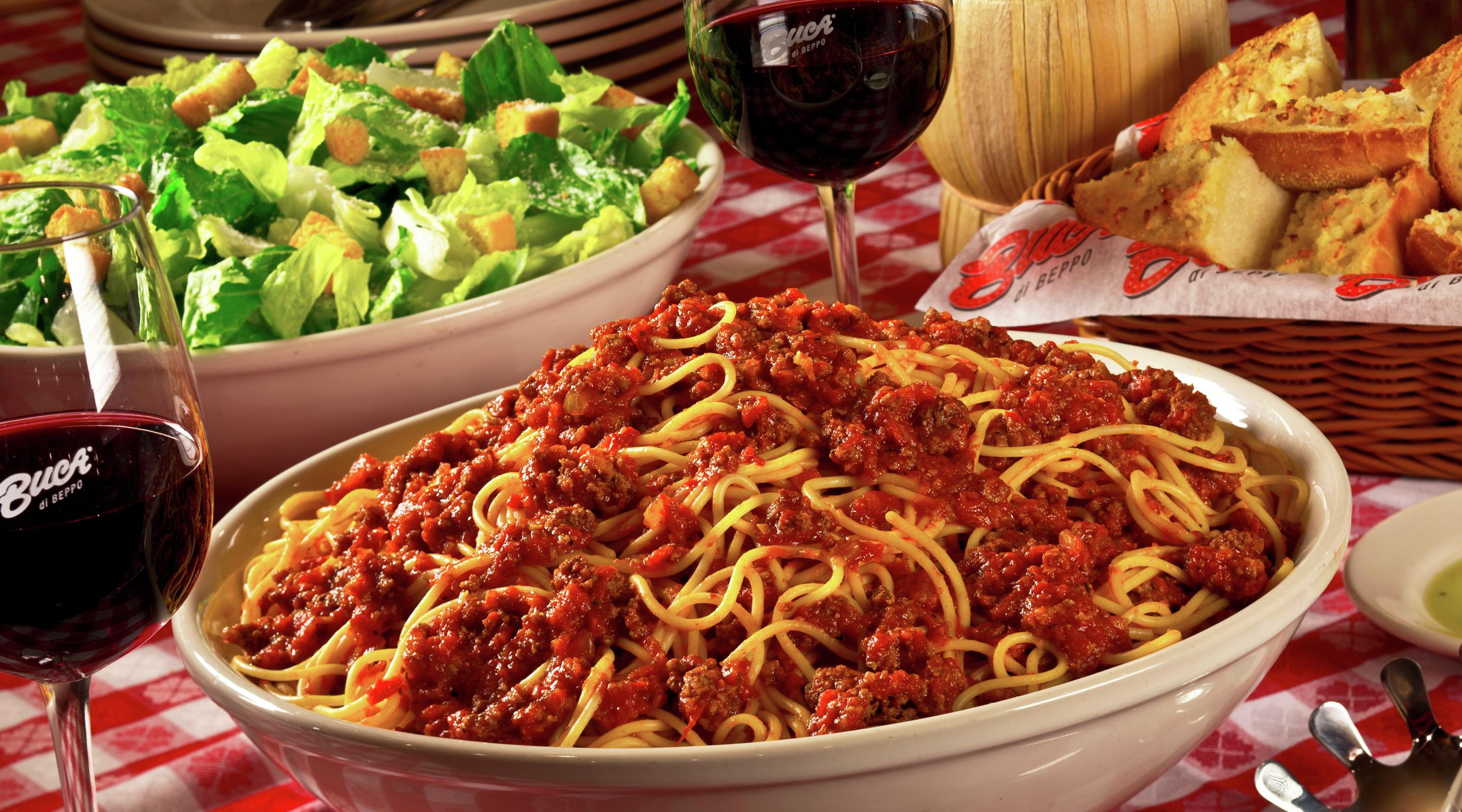 This image is of a spaghetti dinner table set at Buca di Beppo.
