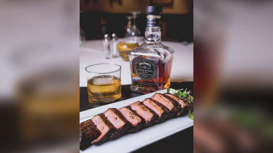 Camelot Steakhouse Lamb Chop & Excalibur's Exclusive Whiskey.