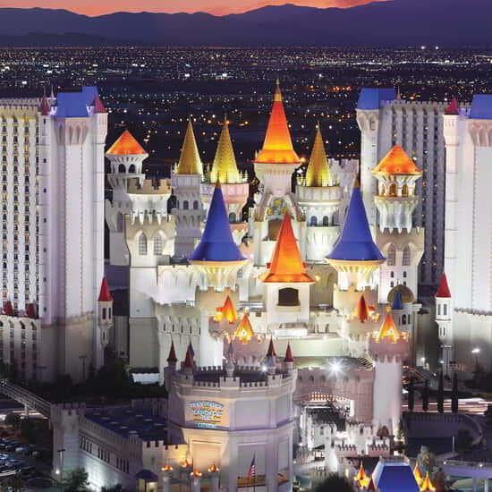 Night time hero shot of Excalibur Hotel and Casino.