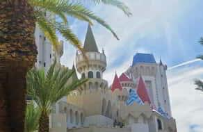 Excalibur Castle behind palm trees.